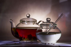 Tea preparation in a glass teapot. On a grey background Stock Images