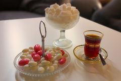 Tea prepared in turkish way, cane sugar and small steel teapot. royalty free stock photos