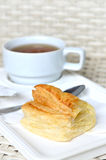 Tea with puff pastry. Tea with a puff pastry Royalty Free Stock Photography