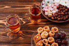 Tea with rahat and dried fruits on a wooden table royalty free stock image