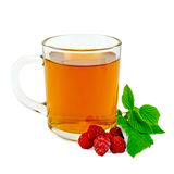 Tea with raspberry in glass mug Stock Photography