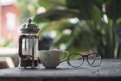 Tea and reading glasses in the Afternoon royalty free stock photos
