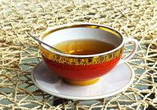 Tea in red cup Royalty Free Stock Photo