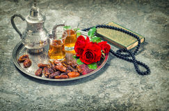 Tea and red rose flower, holy book quran and rosary. Ramadan kareem vintage. Tea and red rose flower, holy book quran and rosary. Islamic holidays decoration
