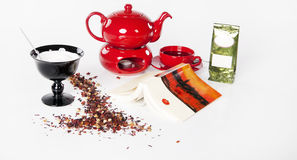 Tea, relaxation set for one person with book. On the white background Stock Photos