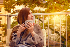 Tea relaxing balcon female. Carefree woman in new home apartement relaxing on terrace royalty free stock photos