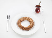 Tea and ring. Image is posed on white background Royalty Free Stock Image
