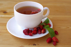 Tea with ripe strawberries Stock Photos