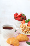 Tea and ripe strawberries Stock Images