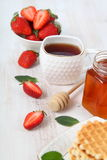 Tea and ripe strawberries Royalty Free Stock Photography