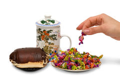 Tea, roll, sweets Stock Photos
