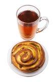 Tea with a rolled bun Stock Photos