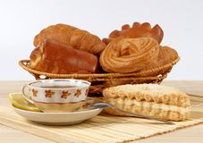 Tea and rolls. There are different types of rolls in the picture. And a cup of tea with lemon. All rolls are very tasty and fresh Stock Image
