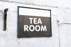 Tea room cafe sign on white wall. Uk stock photography