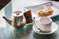 Tea room Darjeeling. With tea pot,cup and cake Stock Photos