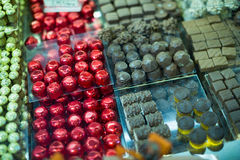 Tea-room display with delicious finest chocolates Royalty Free Stock Images