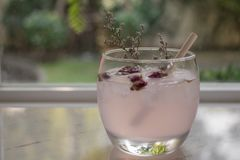 Tea with rose flower petals. Dried flower tea with ice royalty free stock photo