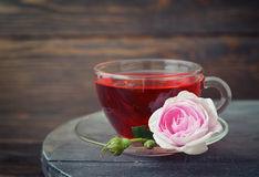 Tea rose flowers and tea Stock Photography