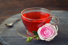 Tea rose flowers and  tea Stock Images