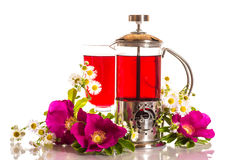 Tea with rose hips with flowers Royalty Free Stock Images