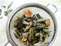 Tea with rose petals and blue flowers Royalty Free Stock Images