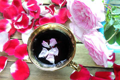 Tea with rose petals Royalty Free Stock Images