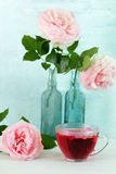 Tea with rose petals. Roses and tea with rose petals stock image