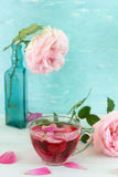 Tea with rose petals royalty free stock photo