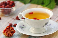 Tea with rosehip on a table. Useful drink for health. Herbal tea. Royalty Free Stock Photography