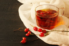 Tea with rosehip on a table. Useful drink for health. Herbal tea. Traditional medicine Stock Photography