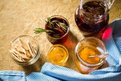 Tea with rosemary, pineapple jam and blue striped napkin. Horizontal Stock Photography