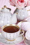 Tea and roses Royalty Free Stock Photos
