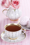 Tea and roses Stock Photography
