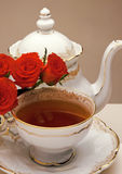 Tea and roses Stock Photos