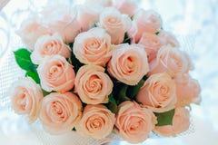 Tea roses bouquet. Closeup beautiful tea roses wedding bouquet background Stock Image