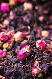 Tea roses and dried hibiscus flower Stock Photo