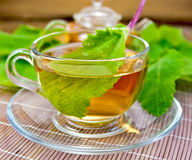 Tea with sage in cup on bamboo napkin Stock Photo