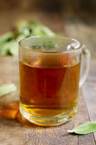 Tea with sage in a glass. Royalty Free Stock Images