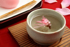 Tea with salted cherry blossoms petal stock photography