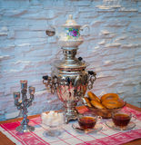 Tea samovar with bagels stock images