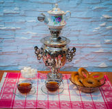 Tea samovar with bagels royalty free stock image