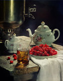 Tea from a samovar and a raspberry. Still-life with tea, a samovar and a fresh raspberry royalty free stock photos