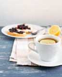 Tea and sandwiches. Lemon tea with jam sandwiches royalty free stock images