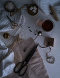 Tea, scales, candles, scissors, letter on the table. space for text. top view. Stock Image