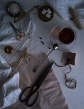 Tea, scales, candles, scissors, letter on the table. space for text. top view. Royalty Free Stock Photos