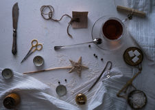 Tea, scales, scissors, letter on the table. space for text. top view. Royalty Free Stock Images