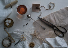 Tea, scales, scissors, letter on the table. space for text. top view. Stock Photos
