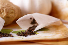 Tea scattered over illustration of herbs Royalty Free Stock Photo
