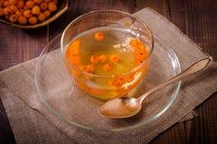 Tea with sea buckthorn Stock Photo