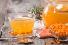 Tea with sea buckthorn Royalty Free Stock Image